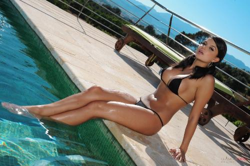 Sasha Cane Taking A Dip In The Pool In Her Small Bikini